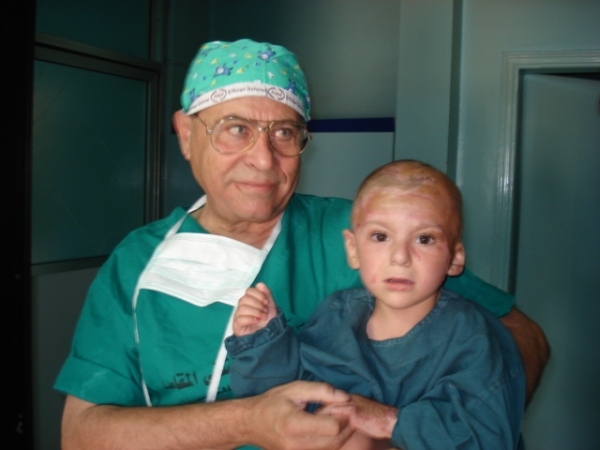 Doctor with young burns patient