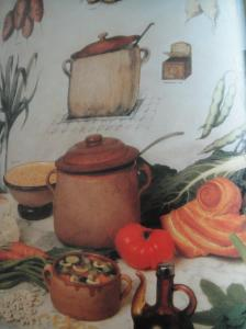 A soup tureen and vegetables