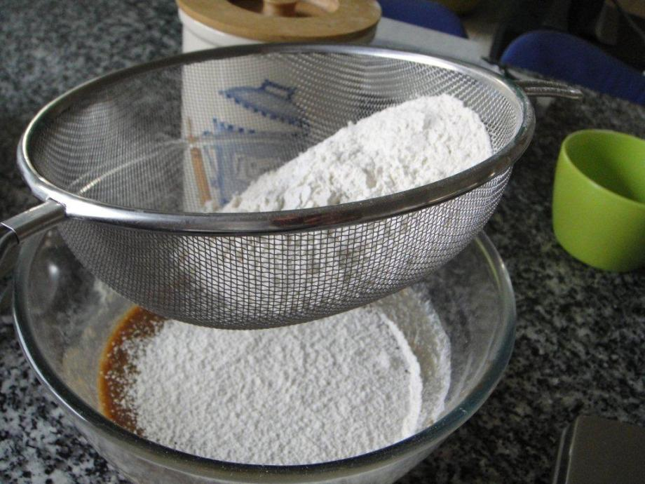 Sifting the flour into the mixture.