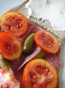 Salami. tomato and gherkin sandwich