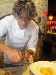 Giorgio Locatelli shaving truffles over pasta