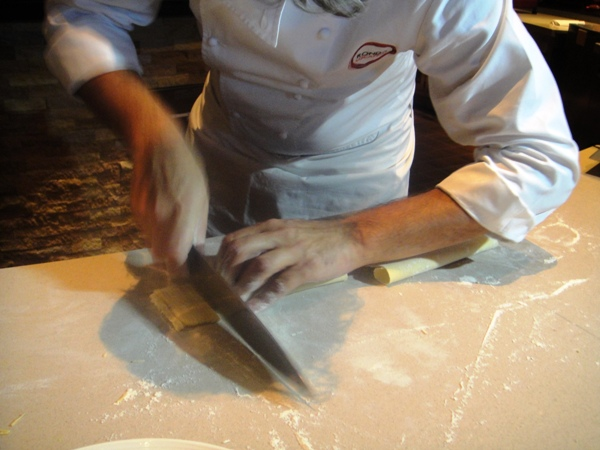 Cutting the pasta into strips
