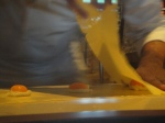 Laying the pasta over the egg yolks