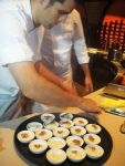 A sous chef from Ronda Locatelli shaves truffle onto risotto