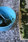 Rolled out dough and parsley and garlic filling
