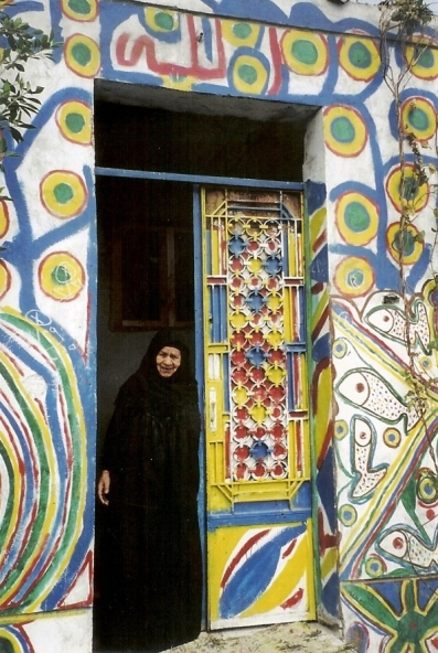 Lady at the door of her house