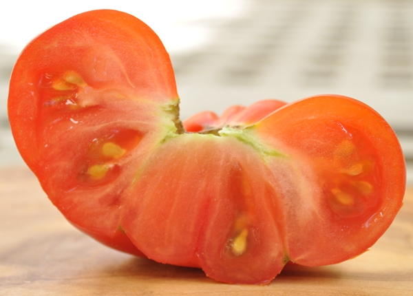 Home-grown tomato cut in half