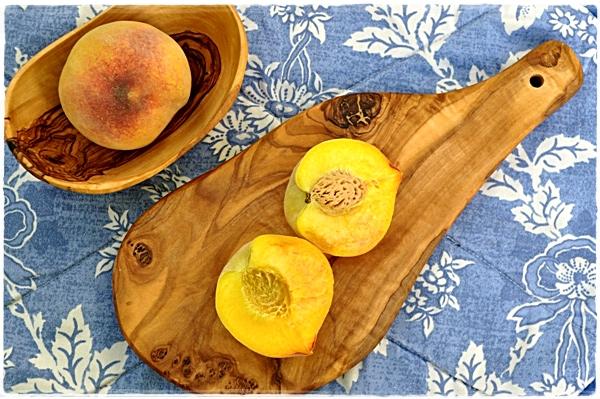 Peaches and a chopping board
