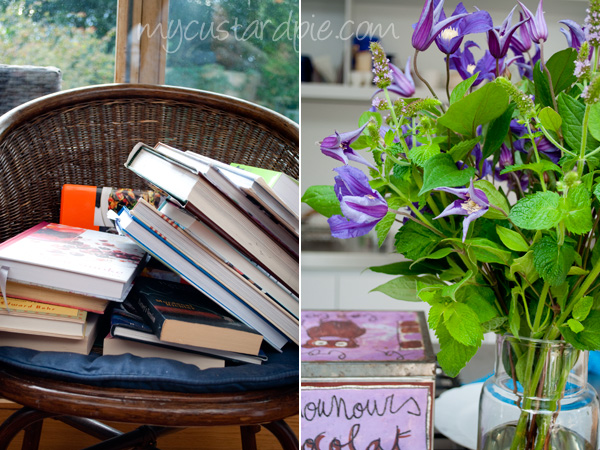 books on a chair, tin and flowers in the kitchen