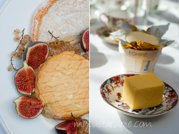Cheese, butter , tea cups at afternoon tea