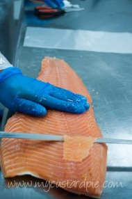Hand slicing smoked salmon at Salmontini smokehouse Dubai - mycustardpie.com