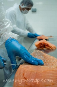 Hand slicing smoked salmon at Salmontinin somokehouse Dubai - mycustardpie.com