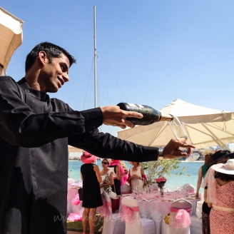 Pouring pink bubbles at a pink lunch