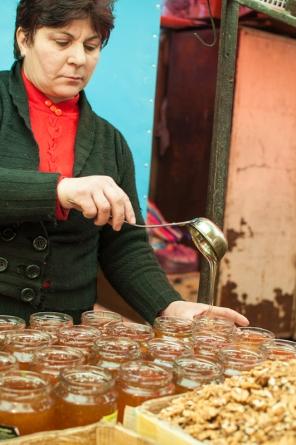 Raw honey seller - Tbilisi Market - My Custard Pie