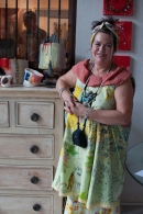Linda Styles with some of her pottery at the Majlis Gallery