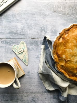 Cup of tea, a heart and a pie