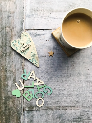 Cup of tea, a heart and the letters to spell Blogtacular