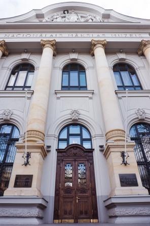 Front of imposing building with wooden front door