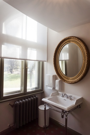 a sink and mirror by a window