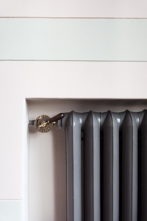 Brass control on a traditional radiator
