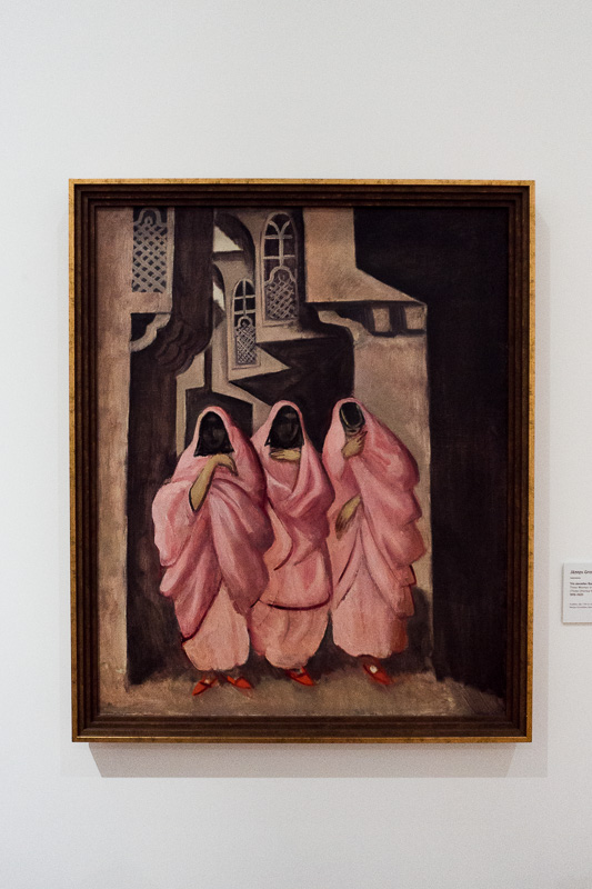 A painting of Arabic ladies wearing pink robes