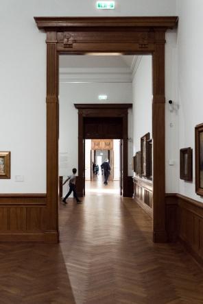 view through a door way down a corridor