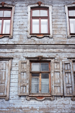 Windows and shutters of an old wooden building