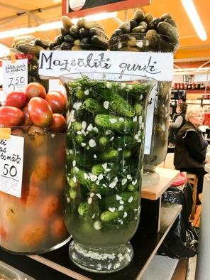 A jar full of cucumber pickles