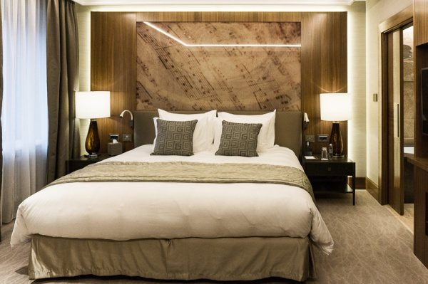 Double bed with brown cushions and music notes on walls