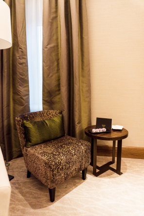 Table and chair in front of curtains