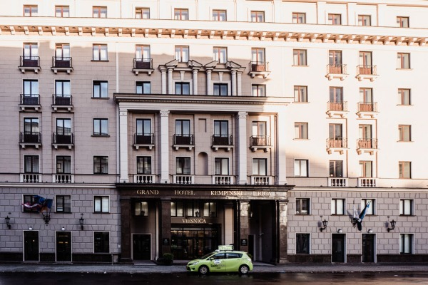 Front of hotel with green car outside