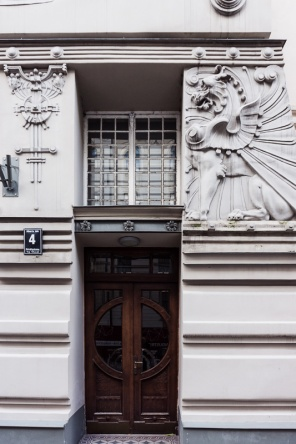 griffen detail by brown door on art nouveau style house in riga latvia
