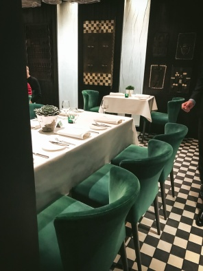 table and green chairs in restaurant