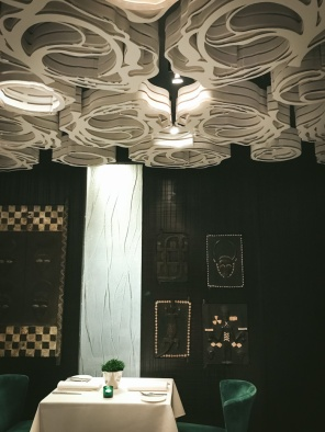 table under ornate ceiling in restaurant