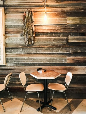 Wooden table and chairs in cafe Riga