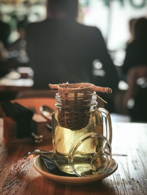 A glass of tea with a strainer