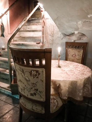 Candle on table with chair in restaurant