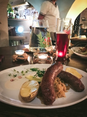 sausages and potatoes and goldfish in bowl on table, riga restaurant