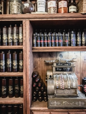Wooden shelves lined with bottles of balsam in Riga