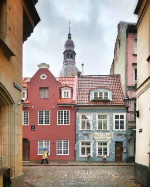 A pink and a blue building in Riga