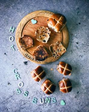 hot cross buns on a bread board
