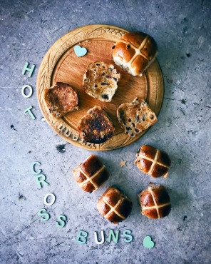 hot cross buns on a bread board