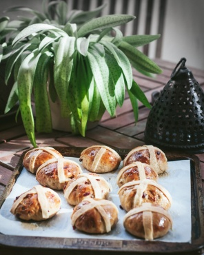 hot cross buns on a baking sheet