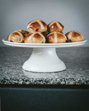 hot cross buns on a cake stand