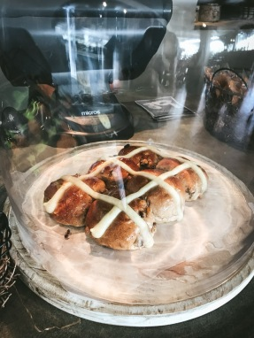 hot cross buns in a glass display dome