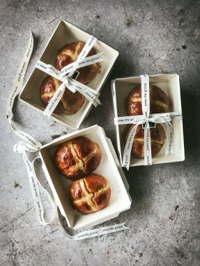 hot cross buns in boxes ties with ribbon