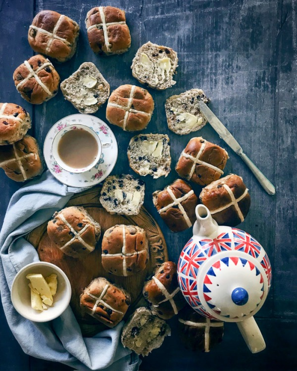 lots of hot cross buns a cup of tea and a teapot