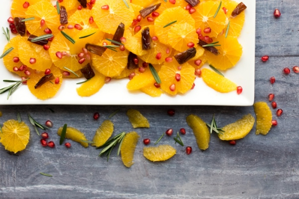 Date and orange fruit salad on a plate