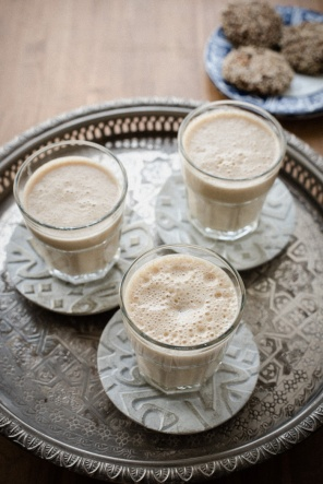 three glasses of lassi on a tray