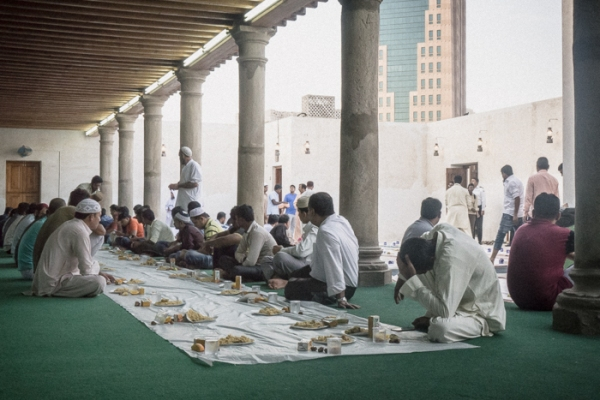 men sitting on the floor waiting for iftar